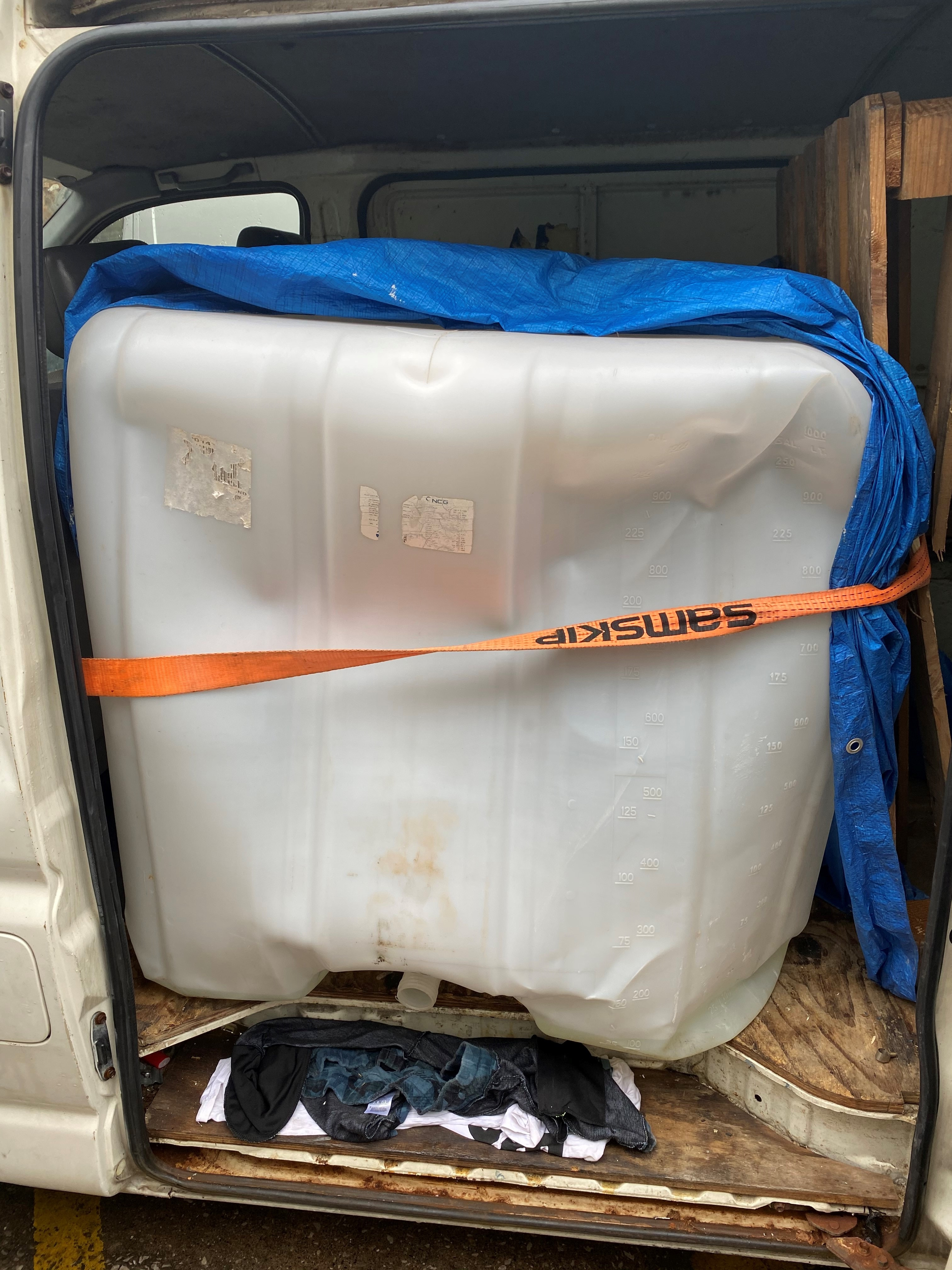 1000 litre fuel container located within the rear of the Toyota Hi-Ace van