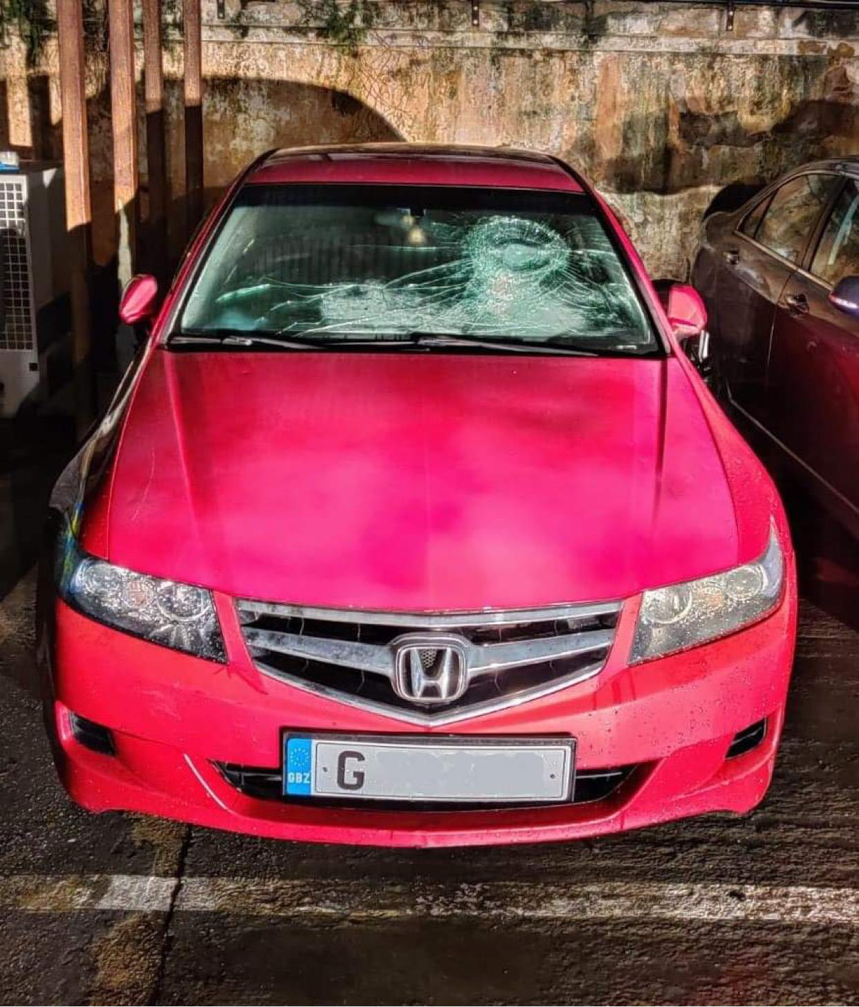 The Honda Accord motor car with a damaged windscreen following the collision with an RGP patrol vehicle.